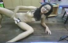 Nerdy Thai girl strips and masturbates